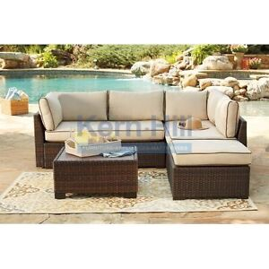 Outdoor sectional with coffee table at  (Kern-Hill furniture)