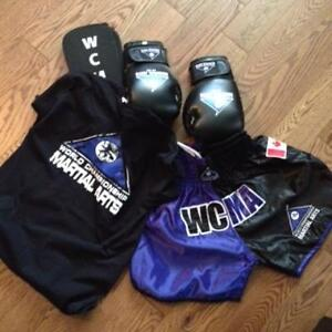Boxing uniform and Gloves and Shin Pads.