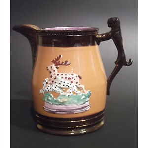 Antique Copper Lustre Pitcher with Raised Deer and Dog Motif