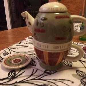 Tea pot and cup
