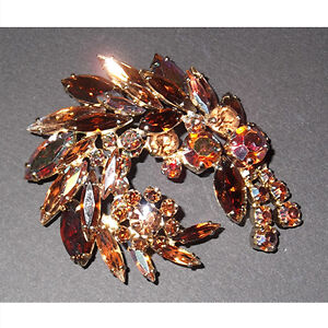 Vintage Sherman feather-shaped brooch