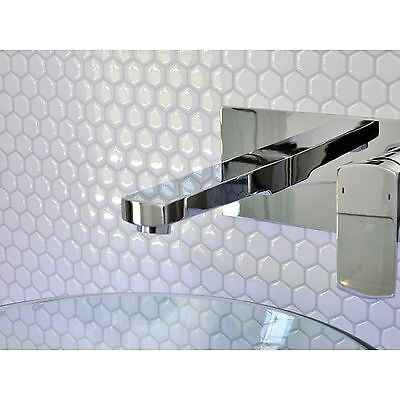 Believe it or not this hexagon tile backsplash is a peel 'n stick version! Click to see more.