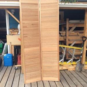 Bifold louvered wood door