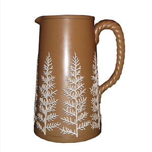 Antique brown salt-glazed pitcher with white fern decoration