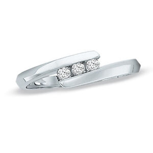 0.12 CT. T.W. Diamond Bypass Ring in 10K White Gold