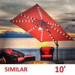 NEW 10' OFFSET LED PATIO UMBRELLA - 125180219 - W/ SOLAR LIGHTS AND BASE TERACOTTA