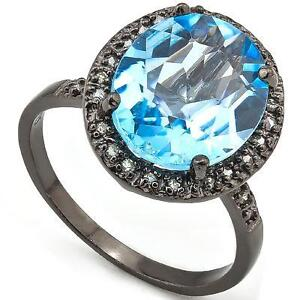 NEW RING- 28 PIECES OF DIAMONDS & 1 SKY BLUE TOPAZ CRAFTED IN A