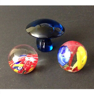 Three vintage art glass paperweights