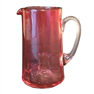 Antique hand-blown cranberry glass milk jug