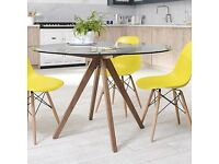Glass Dining Table. Excellent condition. Accommodates 4-6 people. h76cm : dia120cm
