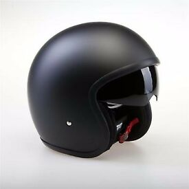 Open face black helmet with integrated Sun visor. Used on Harley Davidson