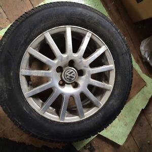 Set of Four 195/65/15 Tires And Aluminum Wheels For A Volkswagen