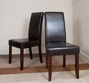 4 black faux leather chairs with solid wood legs