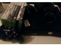 Xbox 360 S console with some games and one controller