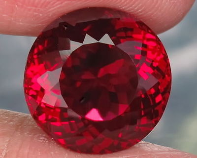 A PAIR OF 6mm ROUND-FACET TOP-RED LAB RUBY GEMSTONES
