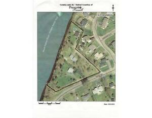 Opportunity Knocks!! Waterfront lot ideal for Development.