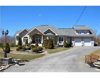 CUSTOM BUILT BUNGALOW FOR SALE IN METCALFE WITH 2 ACRE LOT