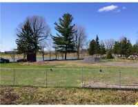 100,000 square feet WATERFRONT lot is ideal for development.