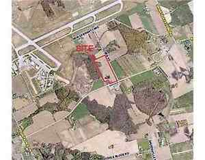 Investment Opportunity -25 Acres of agriculture land. Airport