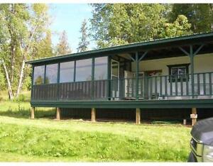 Your little piece of Paradise on 1.5 acres on Quesnel Lake