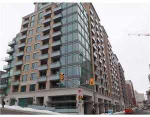 This luxurious new 2 bed+den, 2 bath condo is located downtown
