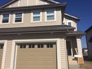 9433 230 ST - Come home to this BRAND NEW Half Duplex!
