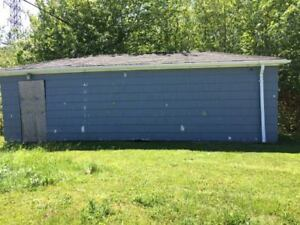 WANT GARAGE MOVED