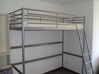 High metal frame bed