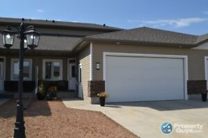 A great place to downsize to in Warman! Offers lots of room!
