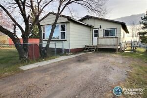 4 Bedroom, 1300 sq ft mobile home on large fenced lot.