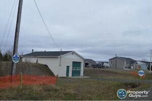 Land with Building that could be converted to 20x40 home