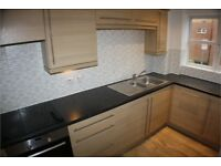 A 2 bed 2 bath flat in Hepburn Court, Station Road Borehamwood WD6