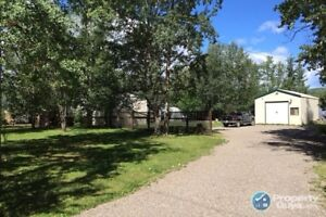 House and shop on a very private 1/2 acre lot for sale