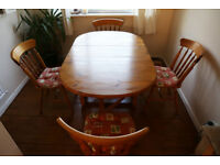 Solid pine gate-leg oval table with four chairs