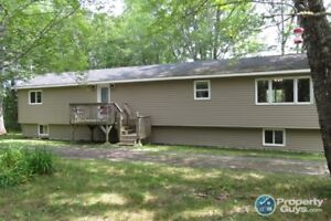Sitting on 4.4 acres with a pond and trail to the woods