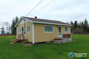 This 2 bed, 1 bath cabin sits on over 4 acres of land