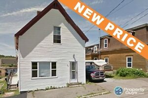 NEW PRICE! Lots of potential, solid structure & good sized lot