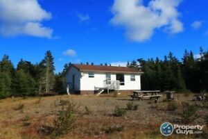 On 5.5 acs, 2 newer homes/cottages along Grand River