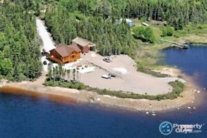 Stunning log home overlooking 500' waterfrontage on 1.25 ac