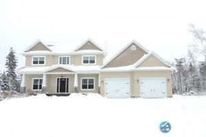Custom built executive two storey home on a 1.1 acre lot