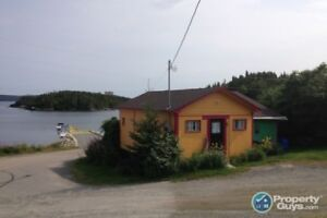 House & cottage on same ocean front property. Owners want sold!