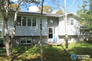 Private on 2 acres with waterfront access. Hobby farm potential!