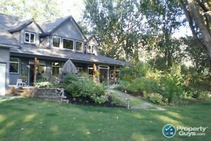Custom built home with 3 separate lots in Genelle ID 30997