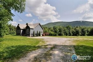 4 Acres, privacy, detached garage, vaulted ceilings & much more!
