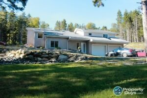3 bdrm on over 19 acres, private, surrounded by a lush forest