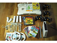Nintendo Wii Full Bundle with Controllers, Wii Fit Balance Board, Games with Many Extras