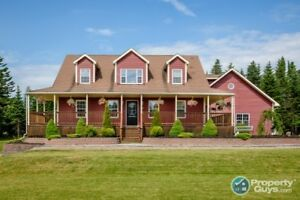 Custom, two storey, Cape Cod sits on a large corner lot