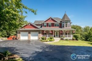 Immaculate 4.72 acre waterfront home with over 4700 sf of space!