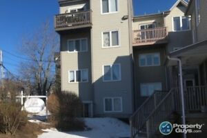 Sun filled townhouse style condo with many upgrades