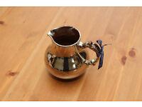 Metallic-look ceramic jug